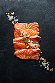 Raw salmon fillet with nuts and onion
