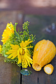 Marigolds and fennel blossoms, with a hollowed out pumpkin as a vase