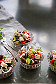 Traditional Greek salad in small glass bowls
