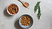 Two bowls of roasted chickpeas with sea salt and honey
