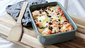 Vegetarian kale lasagne with pumpkin seesd