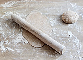 Wholemeal spelt flour dough being rolled out