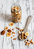 Sweet and salty granola with pecan nuts and dried bananas