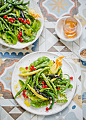 Fresh salad with beans and zucchini blossoms