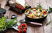 Tagliatella with herbs, small tomatoes and parmesan