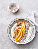 Exotic sheep's quark bowl with mango, amaranth and coconut crunch
