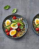Hearty quinoa porridge with avocado, cherry tomatoes and eggs