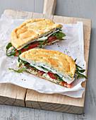 Cloud bread sandwich with feta and rocket salad