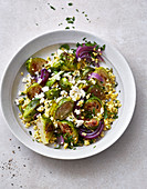 Warm brussels sprouts and millet salad with feta