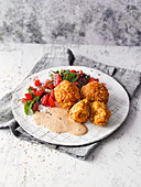 Vegan lentil balls with tahini sauce