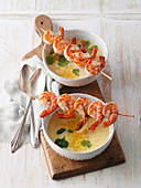 Coconut potato soup with prawn skewers
