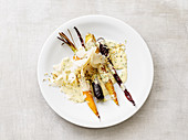 Colourful carrots with coconaise and hemp seeds