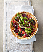 Vegan red wine and onion tart with almond cream