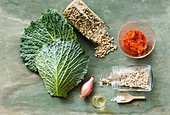 Ingredients for savoy cabbage roulades with minced meat substitute and sunflower seeds