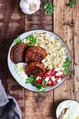 Greek bowl with lentil patties and garlic dip (vegan)