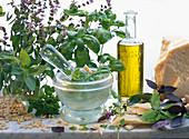 Preparation of pesto: Parmesan cheese, olive oil, basil, pine nuts