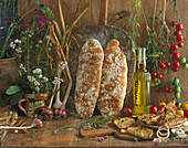 Ciabatta and ingredients for toasted ciabatta with garlic, oil and tomatoes