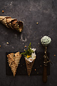 Green ice cream scoop and waffle cone with flowers