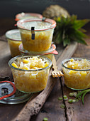 Pointed cabbage with pineapple in preserving jars