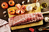 Raw pork ribs on wooden chopping board