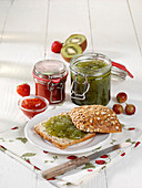Gooseberry-kiwi jam and strawberry jam
