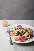 Pink grapefruit salad with onions and almonds