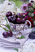 Sweet cherries 'Black Knotted Cherry' in a silver sauce boat