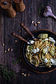 Tagliatelle with artichoke hearts, peanuts and burrata