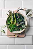 Mini asparagus, Flower Sprouts and spinach in a ceramic bowl