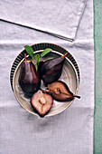 Red wine pears in a ceramic bowl