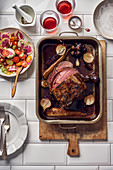 Entrecote roast served with salad with grapes, watermelon radish and tomatoes
