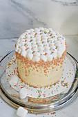 Marshmallow cake with sugar sprinkles