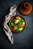 Moroccan chicken tagine with lemons and peas