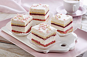 Layer cake with raspberry and cream foam