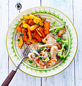 Broccoli chicken stir-fry with yellow and red carrots