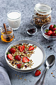 Granola with strawberries and honey