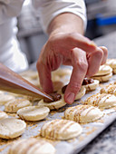 Filling macarons with cream