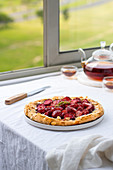 Strawberry galette on a table by a window