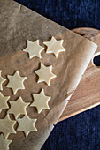 Unbaked pastry stars on parchment paper