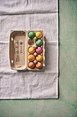 Colorful Easter eggs in an egg carton