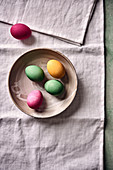 Colored Easter eggs in a ceramic bowl