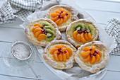 Vegan Danish pastry with kiwis, vanilla curd, and mandarins