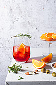 Negroni cocktail with oranges and rosemary