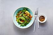 Rocket salad with avocado, mandarin and almond dressing