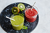 Beetroot and carrot smoothie, and a parsley and kiwi smoothie
