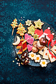 Various colourful Christmas biscuits on plate