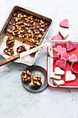 Cashew caramel confectionery and almond hearts with cassis icing