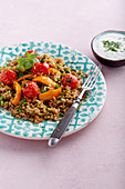 Fried freekeh with vegetables and mint yoghurt