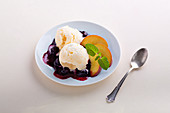 Yoghurt sorbet with blueberry sauce and peaches