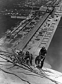 Workers drilling during construction of the Coulee Dam, USA